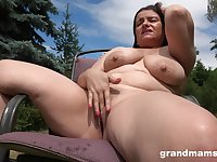 Horny milf masturbates in the garden thinking about hard penis