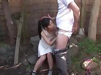 Small Asian dark-haired is deep-throating her neighbor's prick while others are waiting for fellatios