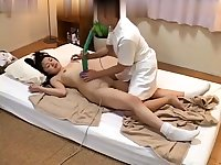 Asian massage slut sucks cock during nuru massage