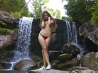 Wide hipped Latina teen with a big ass posing half naked by the waterfall